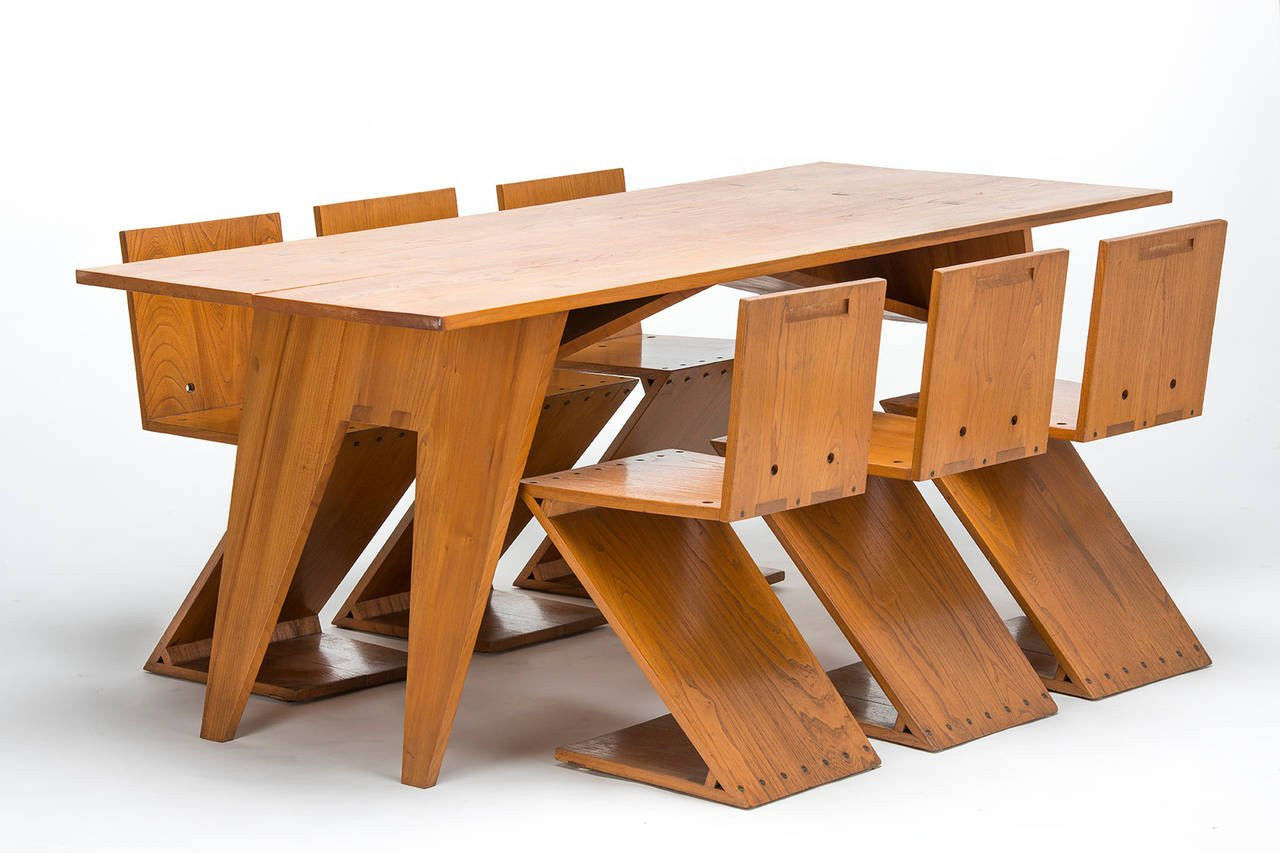 Zigzag table with 6 matching chairs by Gerrit Rietveld