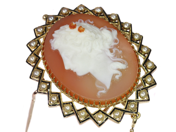 Victorian hard stone cameo in gold mounting with half seed pearls black enamel by Unknown Artist