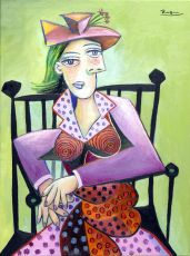 Seated woman in a polka dot dress