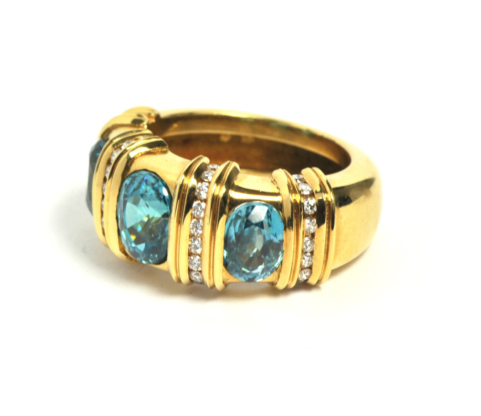 Ring with three turqouise blue Zirkons in yellow gold and brillant cut diamonds by Puck Eigenmann