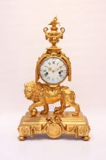A large French Louis XVI ormolu 'lion' mantel clock by Unknown Artist