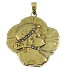 Typical Art Nouveau gold locket woman head on four leaf clover by Unknown Artist