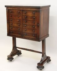 A Regency rosewood collectors cabinet on separate base.