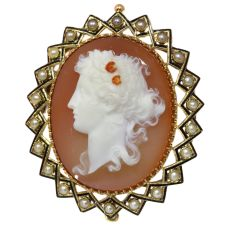 Victorian hard stone cameo in gold mounting with half seed pearls black enamel by Unknown