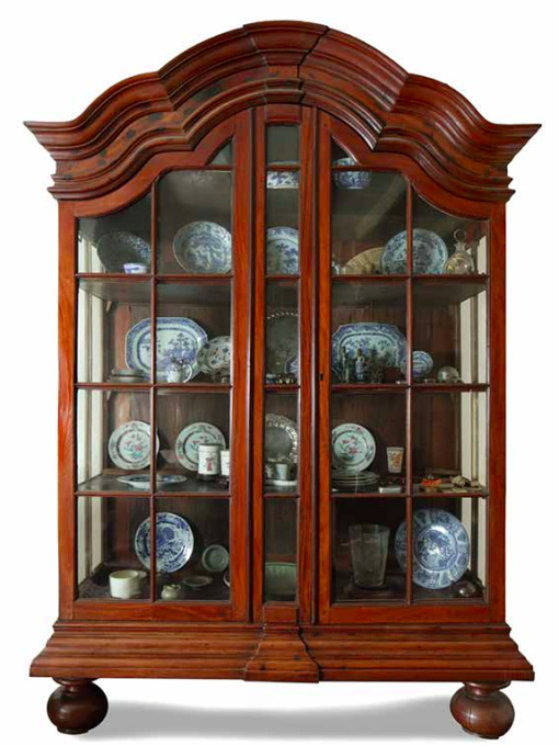 A HIGHLY IMPORTANT LARGE INDONESIAN RED SANDALWOOD (PTEROCARPUS SANTALINUS) DISPLAY CABINET by Unknown Artist