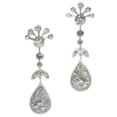 Vintage long pendent platinum cocktail ear jewels abundantly set with diamonds by Unknown