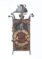 A large South German gothic polychrome painted iron wall clock, circa 1600 by Unknown Artist