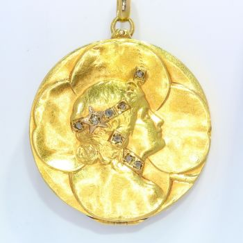 Vintage Art Nouveau lucky locket with four leaf clover and womans head set with diamonds by Unknown Artist