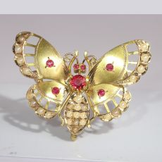 Late Victorian gold butterfly with red strass stones and half seed pearls by Unknown