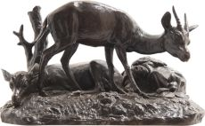 Bronze sculpture of an upright and a sleeping hind