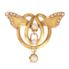 Antique gold brooch with butterfly wings set with half seed pearls by Unknown