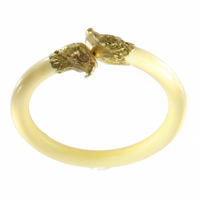 French Late Victorian antique ivory bangle with big gold eagle head ornaments by Unknown