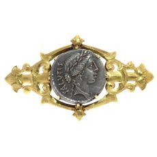 Antique silver Roman coin mounted in antique Victorian brooch by Unknown