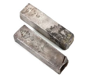 TWO SILVER 'V.O.C. AMSTERDAM' INGOTS by Unknown Artist