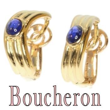Vintage earclips signed Boucheron set with cabochon sapphires by Boucheron .