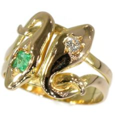 Antique serpent ring with diamond and emerald double headed snake ring by Unknown Artist