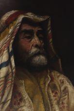 Portrait of a man in traditional Arab garb
