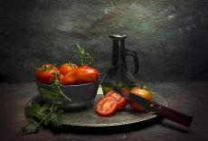 Tomato on a plate  by Mos Merab Samii