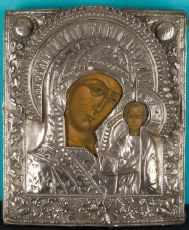 Russian wooden icon with silver oklad: The Mother of God of Kazan by Unknown Artist