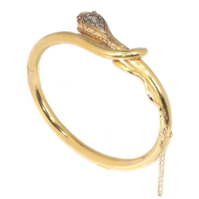 Antique snake bangle set with diamonds and rubies by Unknown Artist