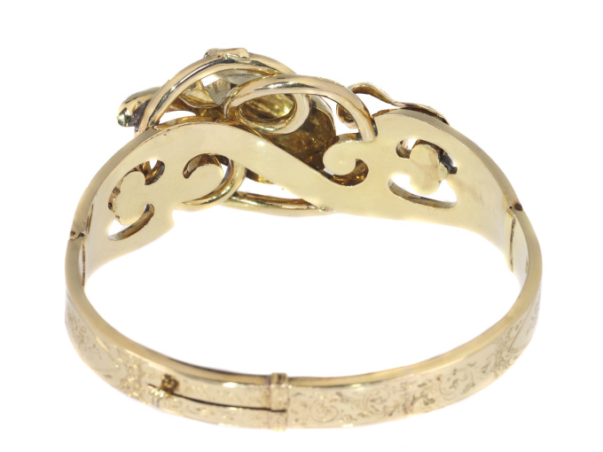 Antique gold bangle with large tulip motive by Unknown Artist
