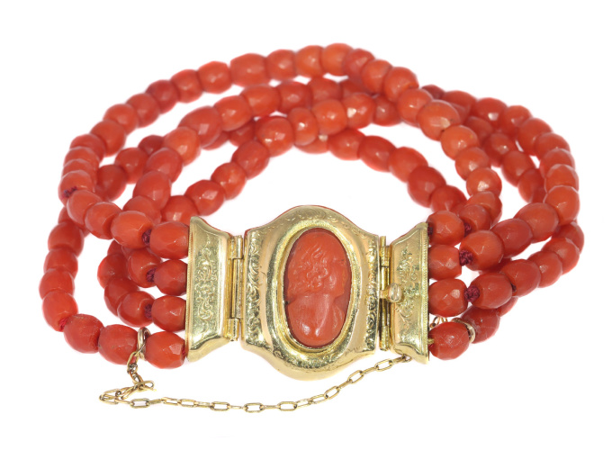 Antique four string coral bracelet with coral cameo in 18K gold closure by Unknown Artist