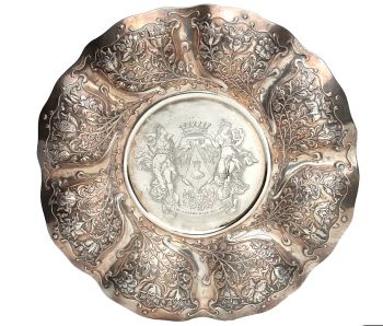 AN UNUSUAL INDONESIAN LOBBED SILVER DISH by Unknown Artist