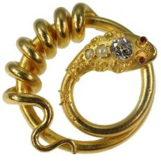 Antique gold snake or serpent brooch with big diamond by Unknown