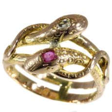 Antique gold double headed snake or serpent ring with ruby and diamond by Unknown