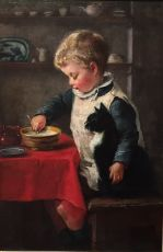 A boy with his cat at the table
