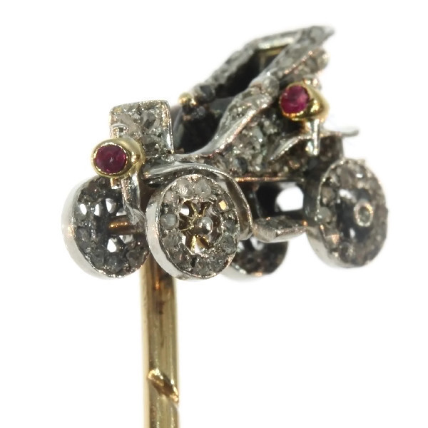 Antique bejeweled tiepin showing one of the first cars by Unknown