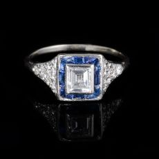 Baguette cut diamond with sapphire surround ring