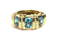 Ring with three turqouise blue Zirkons in yellow gold and brillant cut diamonds