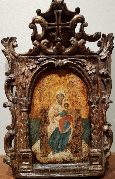 Greek icon: Virgin Enthroned, in carved frame by Unknown Artist
