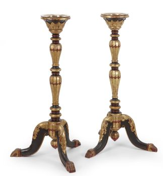 A PAIR OF INDONESIAN LACQUERED AND GILT TEAK TORCHÈRES OR CANDLE STANDS by Unknown Artist