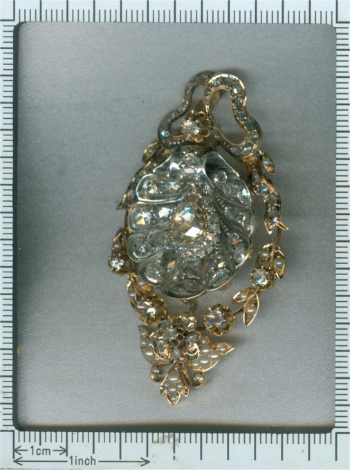 Antique pendant with big shell covered in diamonds can also be worn as brooch by Unknown