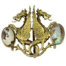 Charming Victorian brooch depicting two griffons protecting their egg by Unknown Artist