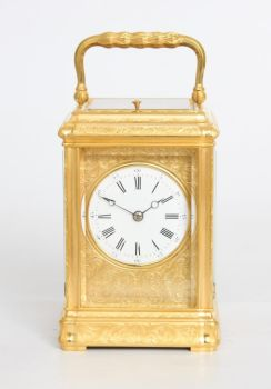 A French engraved gilt brass gorge case carriage clock, circa 1870 by Unknown Artist