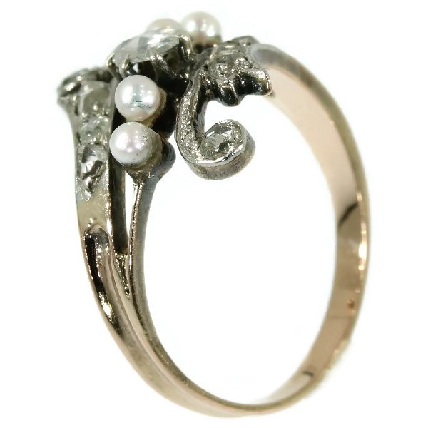 Decorative antique ring with rose cut diamonds and pearls by Unknown Artist