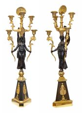 An impressive pair of French ormolu and patinated bronze five-light candelabra crowned with two peac