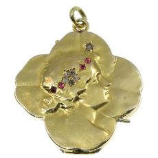 Typical Art Nouveau gold locket four leaf clover with woman head by Unknown Artist