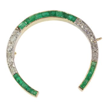 Vintage Art Deco horse shoe brooch set with diamonds and emeralds by Unknown Artist