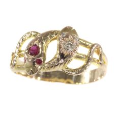 Late Victorian gold snake serpent ring set with diamonds and rubies by Unknown Artist