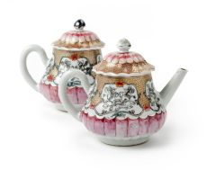 A pair of Chinese famille rose lotus-shaped teapots and covers