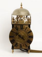 A French iron and brass lantern clock by Couchon A Paris, circa 1725 by I. Couchon A Paris
