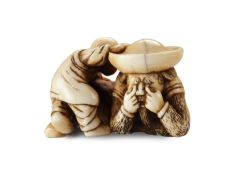 AN IVORY NETSUKE OF A DUTCHMAN FROLICKING WITH A SMALL BOY by Unknown Artist
