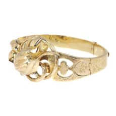 Antique gold bangle with large tulip motive by Unknown