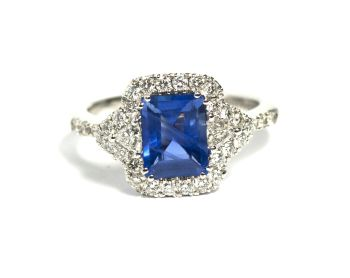 White gold ring with a baguette cut sapphire by Puck Eigenmann