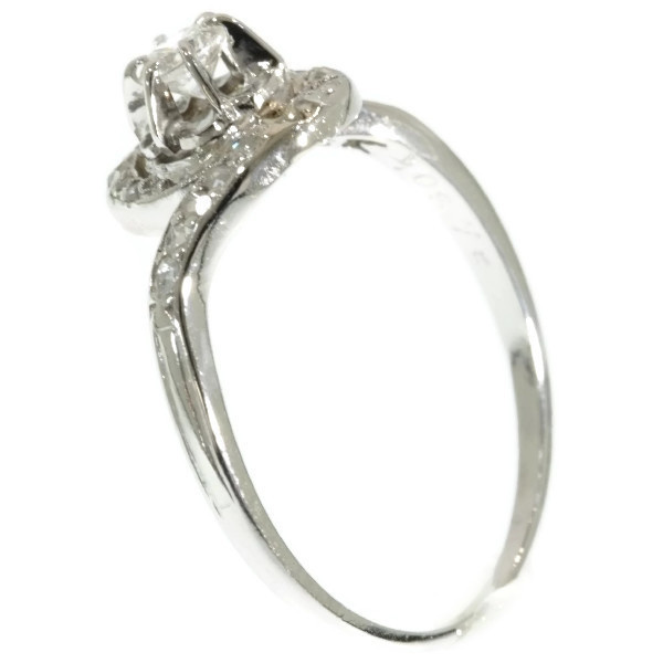 Art Deco curled up platinum ring with diamonds by Unknown Artist