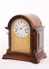 A fine and small English rosewood striking table clock, Charles Frodsham, circa 1850. by Charles Frodsham London